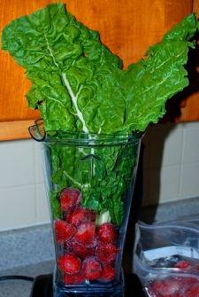 Swiss Chard and Strawberries into the blender